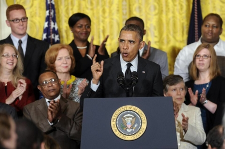 "aka Barack Hussein Obama II at the White House, 30 April 2014, with his clapping Mother, aka ""Elizabeth Ann Duke"" aka ""[Jo] Ann Newman"" at his left shoulder [AP Photo]"